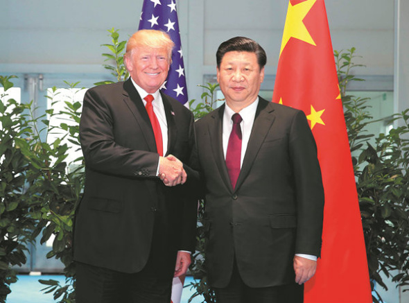 Chinese President Xi Jinping (R) meets with his U.S. counterpart Donald Trump to discuss bilateral ties and global hot-spot issues on the sidelines of a Group of 20 (G20) summit, in Hamburg, Germany, July 8, 2017. (Xinhua/Yao Dawei)